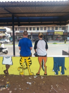 cartoons on a bus stop in mangalore india travel
