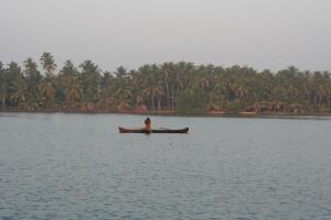 fisherman boat backwaters kerala india