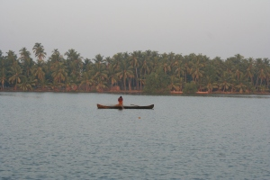 fisherman boat backwaters kerala india